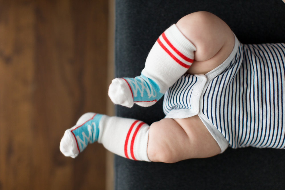 Basketball shoe baby socks by Cheski Sock Co .Designed to not fall down!