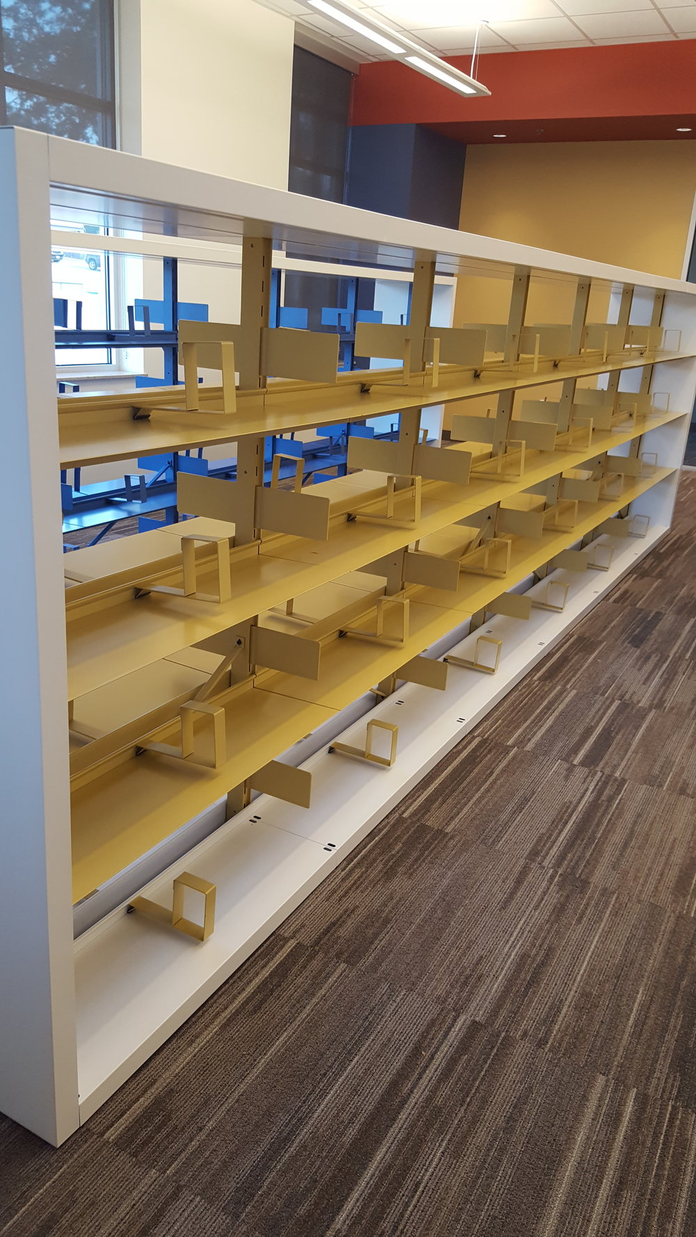 Close Up 60 inch double faced yellow shelving.jpg