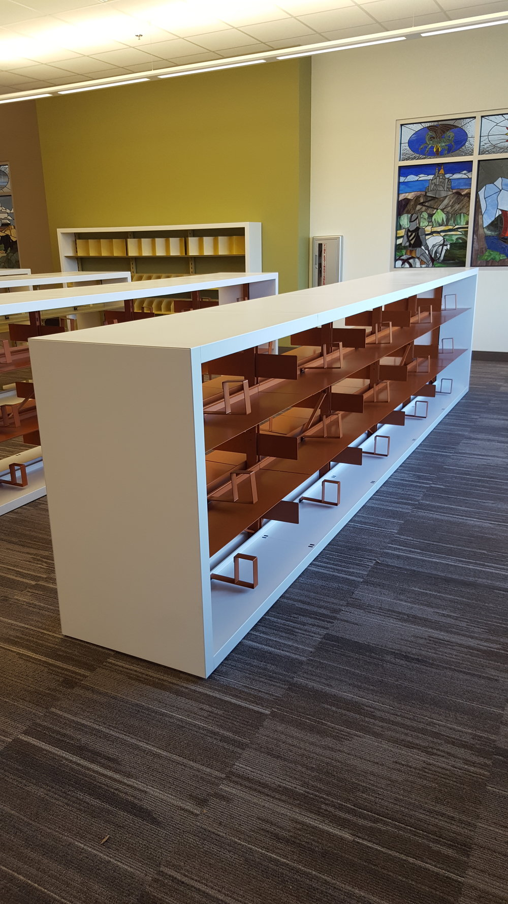 Close up double faced 42 high orange shelving.jpg