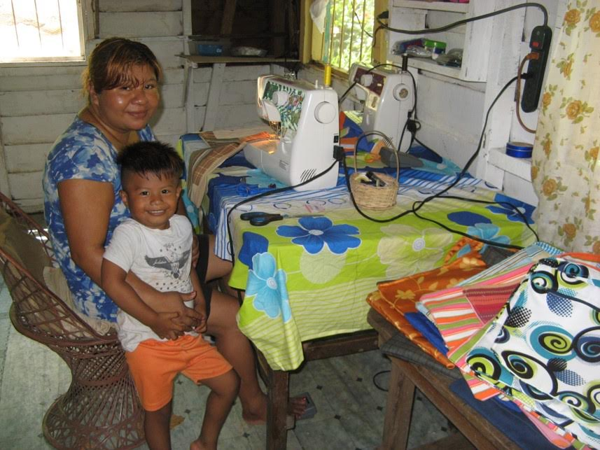 Maria Sewing with child.jpg