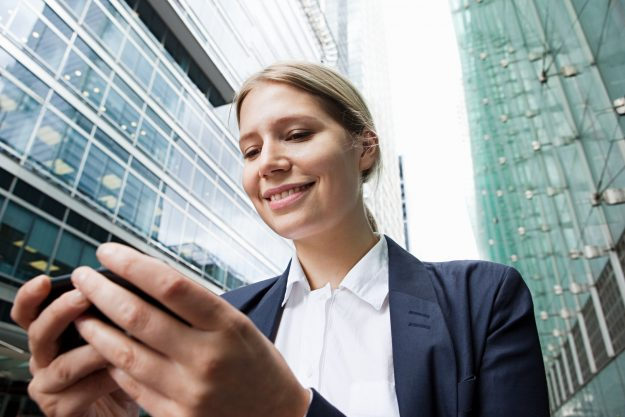 businesswoman-using-smartphone-getty.jpg