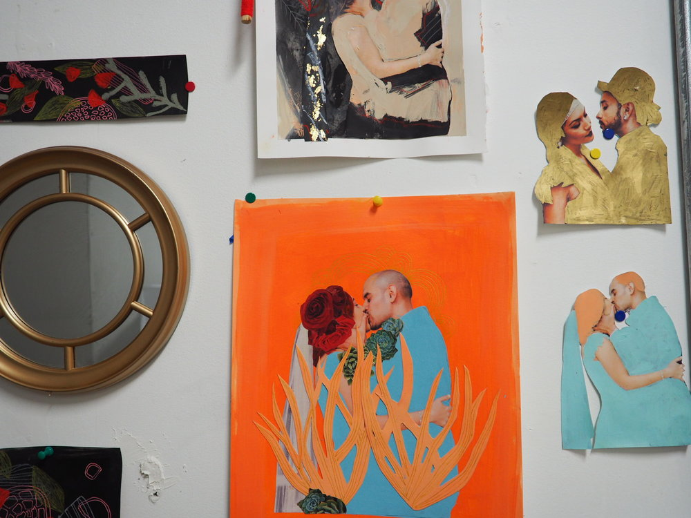 Her collage work decorates the studio's white walls.