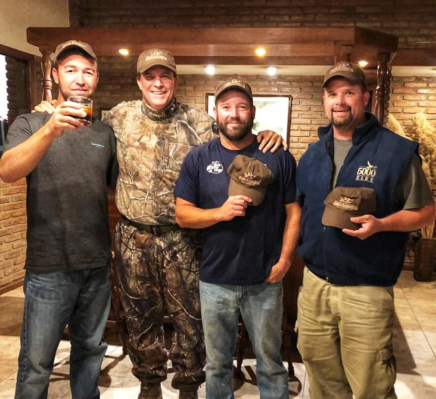 four men posing