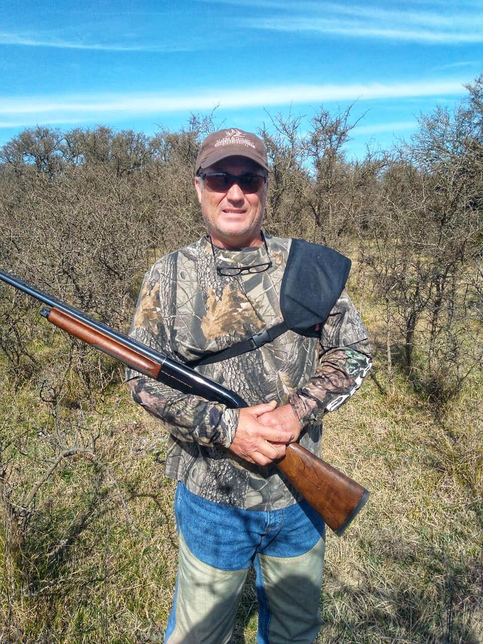 man posing with his gun