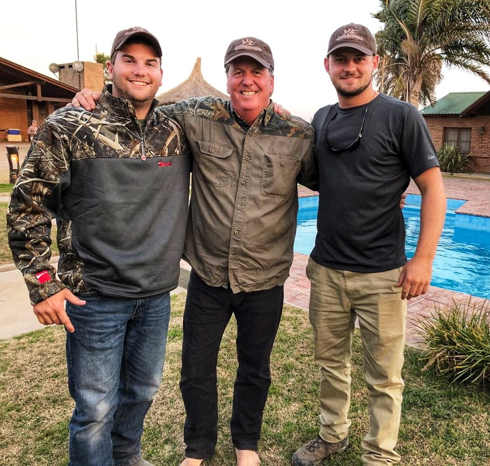 three men posing
