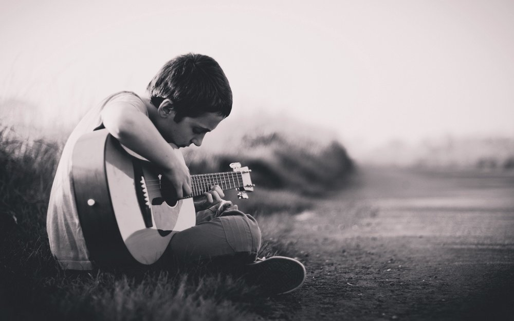 cms unsplash teen with guitar.jpeg