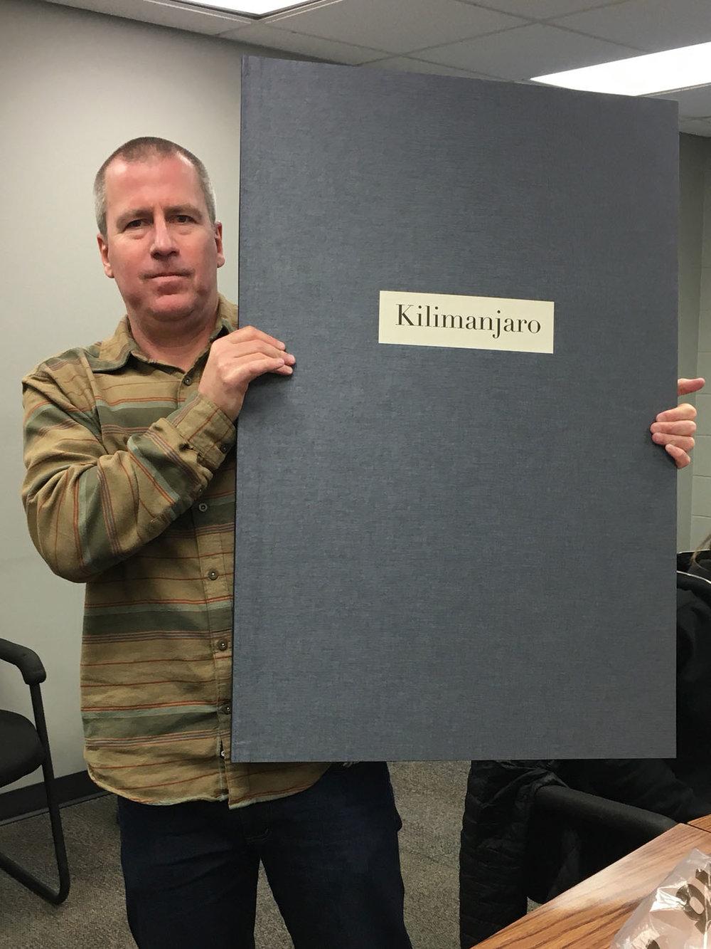 Ian holding  Kilimanjaro  artist book proof copy