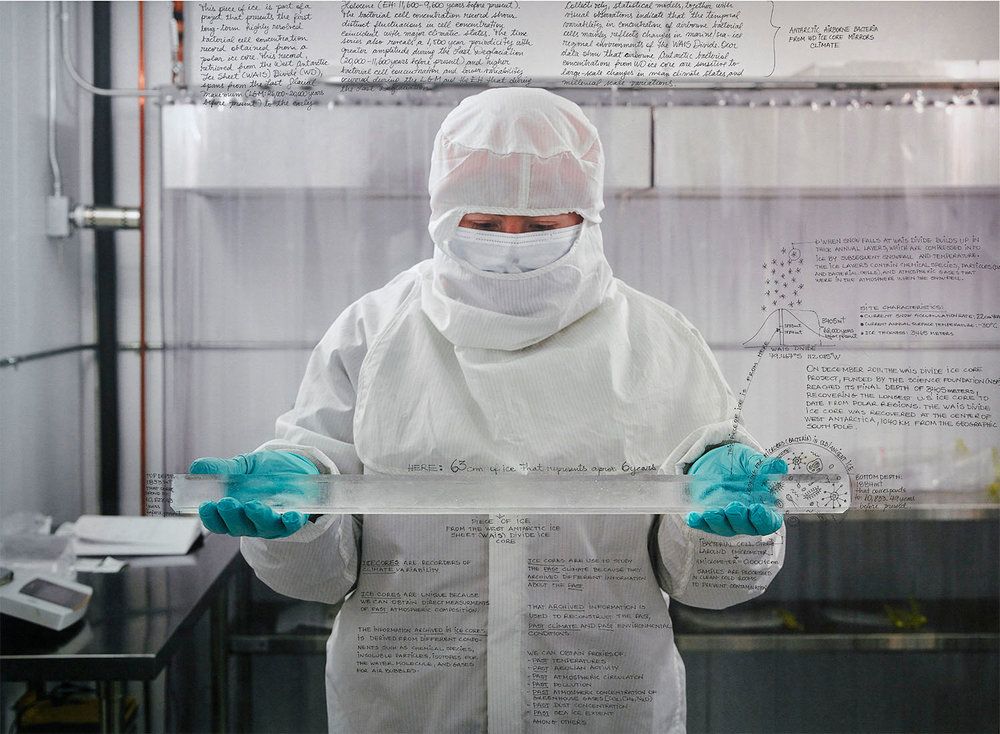 """Dr. Avila holding cut Antarctic Ice Core. 30""""x40"""" 2017 Handwriting (in ink) on Pigment print on Niyodo Washi paper"""
