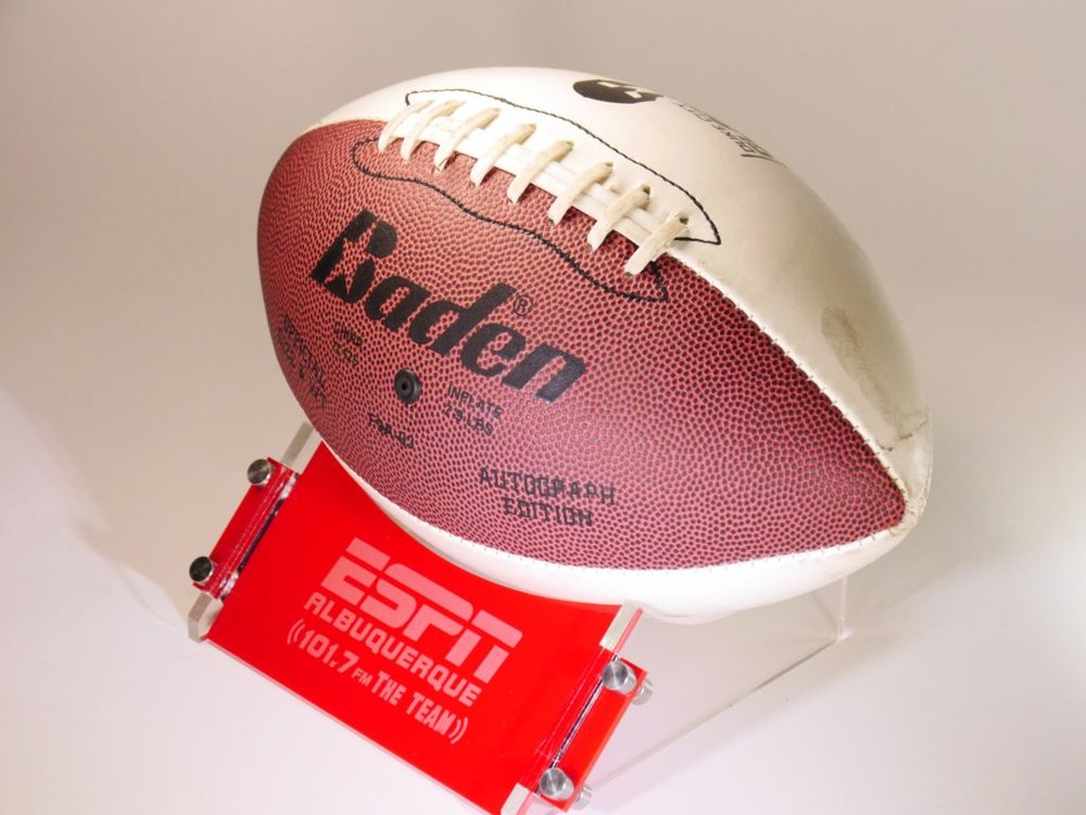 Football Stand (for full size ball) - 3 piece acrylic w/SS hardware assembly, custom etched to your specifications with your logos/imagery and text.  Contact us for design and pricing information.