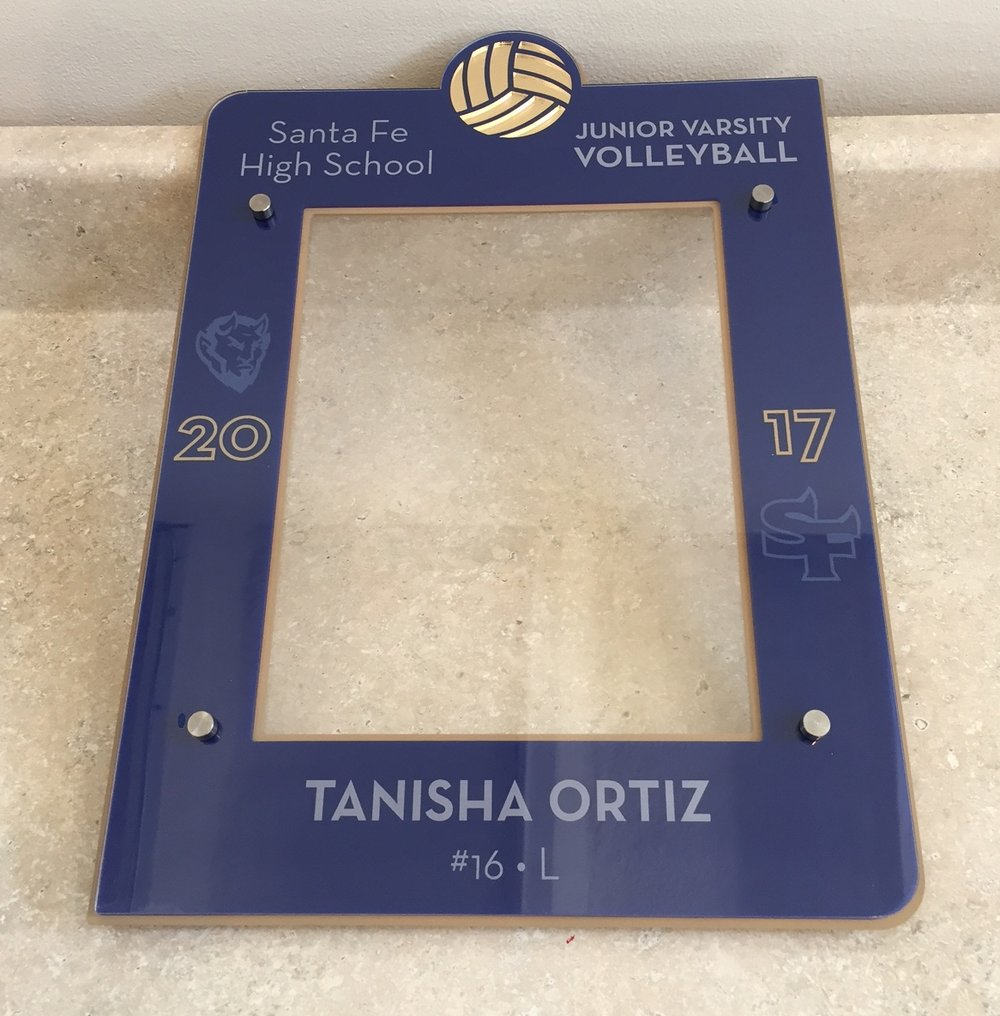 8x10 Portrait photo frame - inlay or color-enhanced ball, custom etch of school, team, year, recipient's name and number, and school logo  Contact us for pricing information.