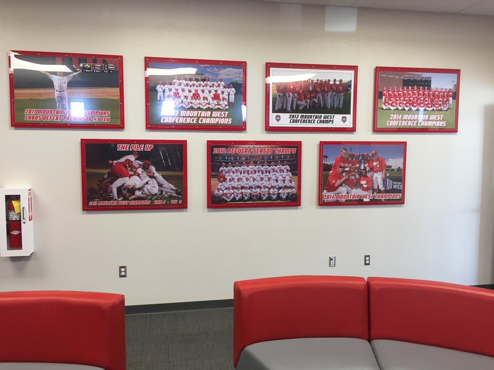 "UNM Lobo Baseball Team Film Room - multiple 36""x 24"" celebratory, foam-core backed photo - frame installation example."