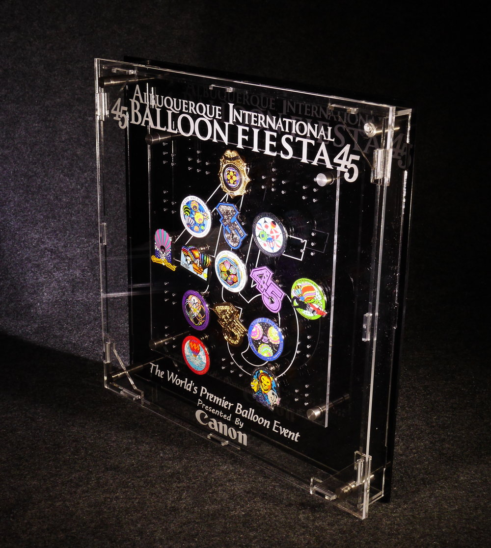 Commemorative Pin Display - Box designed for the Albuquerque International Balloon Fiesta holds events annual pin collection (available only through the Albuquerque International Balloon Fiesta Store).  Contact us to discuss the design of and pricing information for your collection.
