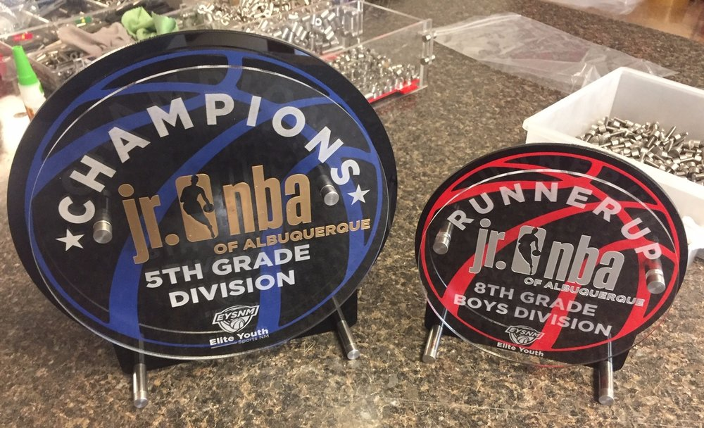 Jr. NBA of Albuquerque Basketball Awards - Champion and Runner Up, featuring gold and silver color enhancing,  Custom etch includes sponsor identification, and division  Contact us for design and pricing information.