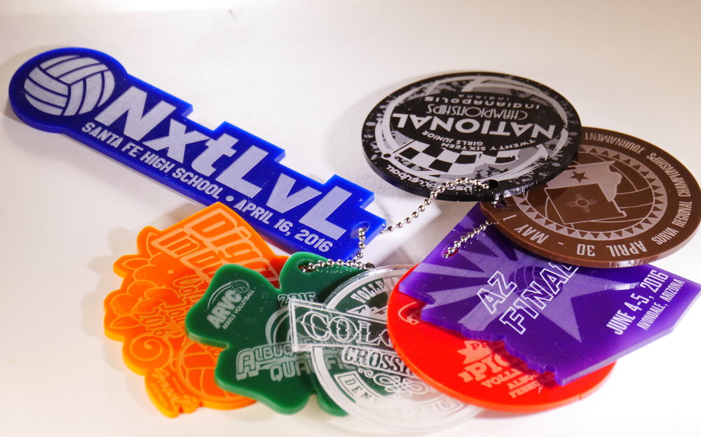 """Bag Tags - For your event, 3 1/2"""" nominal D, custom cut acrylic shapes and marking (one or two sided), many stocked colors, on ….vinyl band, ball chain, carabiner, or 1 3/8""""D keyring.  Contact us for design and pricing information."""