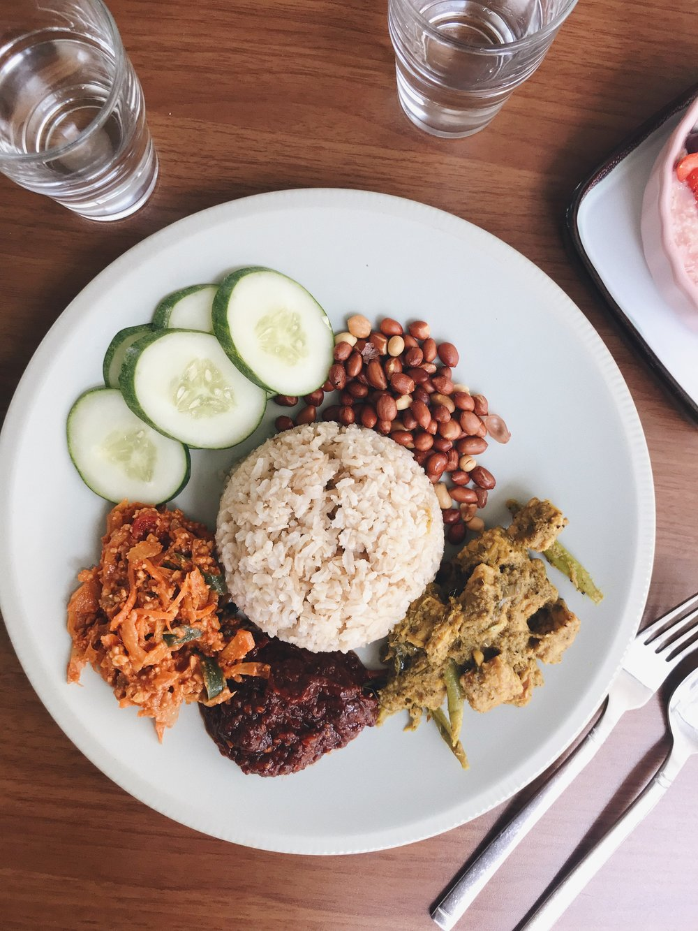 Nasi lemak kukus with tempeh rendang, achar, steamed coconut brown rice & sambal.  - RM21