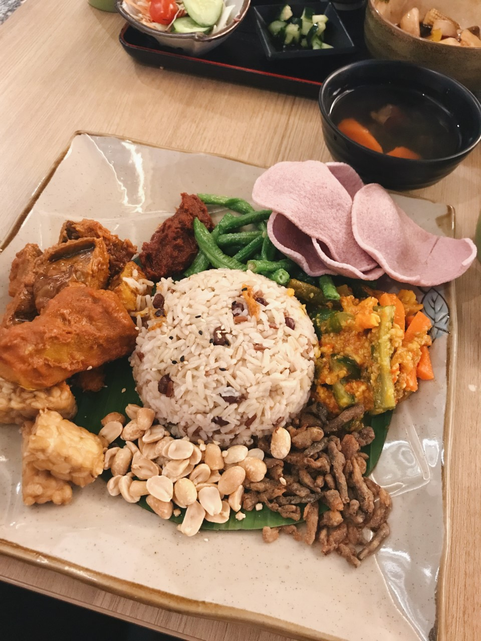 Multigrain rice nasi lemak with pumpkin rendang, tempeh, achar & green beans. - RM17.90