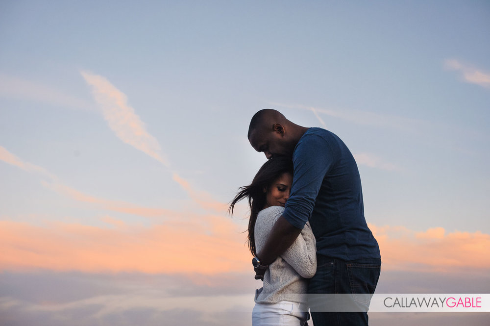 Snuggly engagement photo at Point Fermin Park
