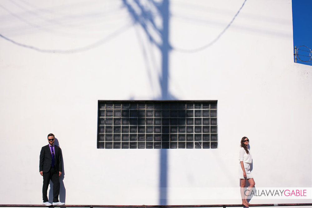 Wide engagement photo in downtown Los Angeles with shadows