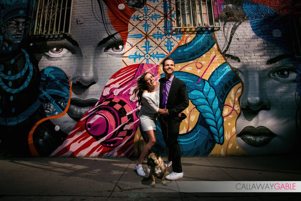 Super cool engagement photo shot with strobe in front of street art