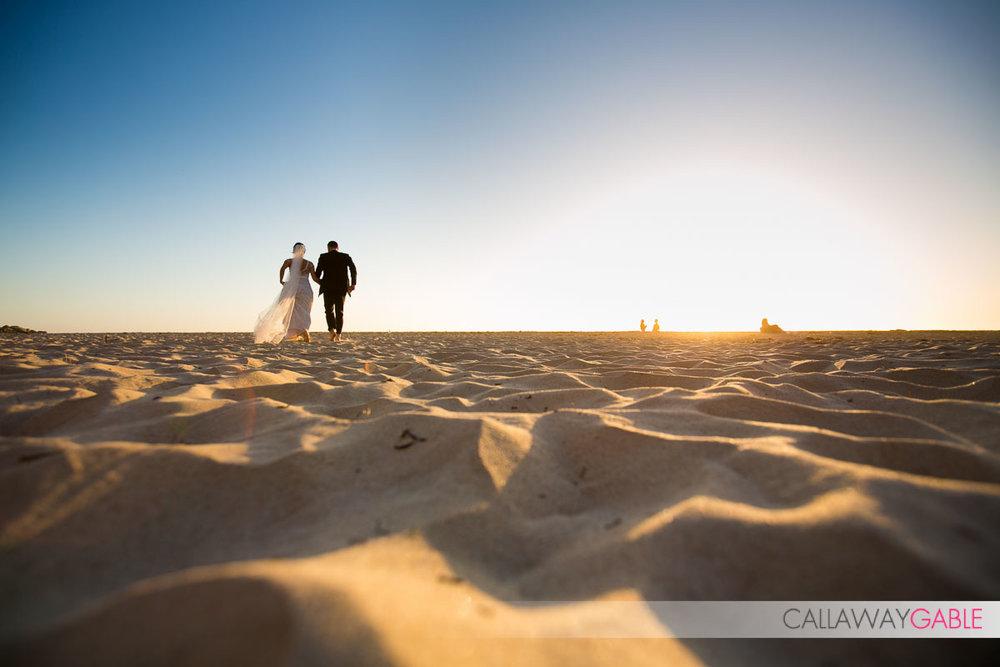 Walking on the beach wedding photo in Laguna Niguel