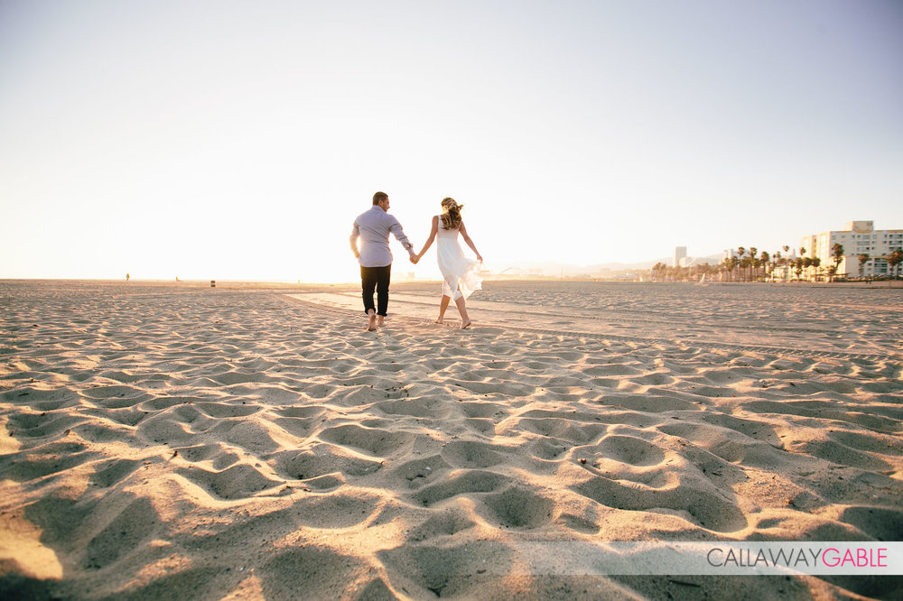 Running on the Santa Monica Beach Engagement Photos