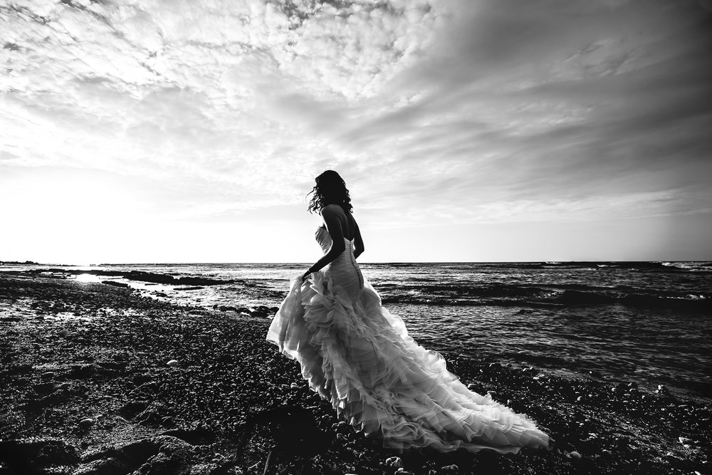 Bride on beach at her Four Seasons Hualalai Wedding by Callaway Gable