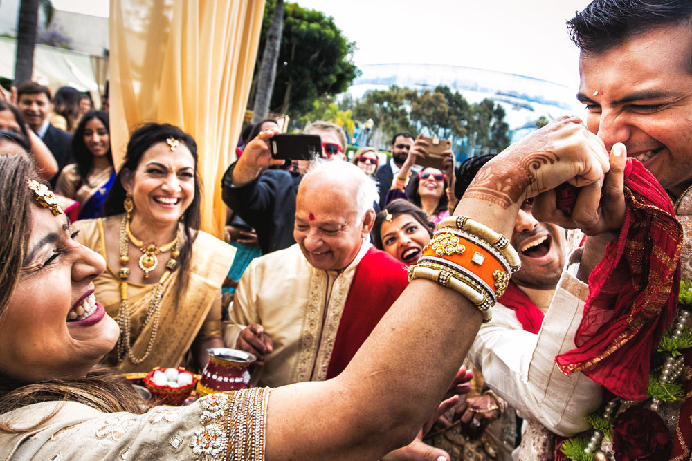 Groom getting his nose grabbed at South Asian wedding