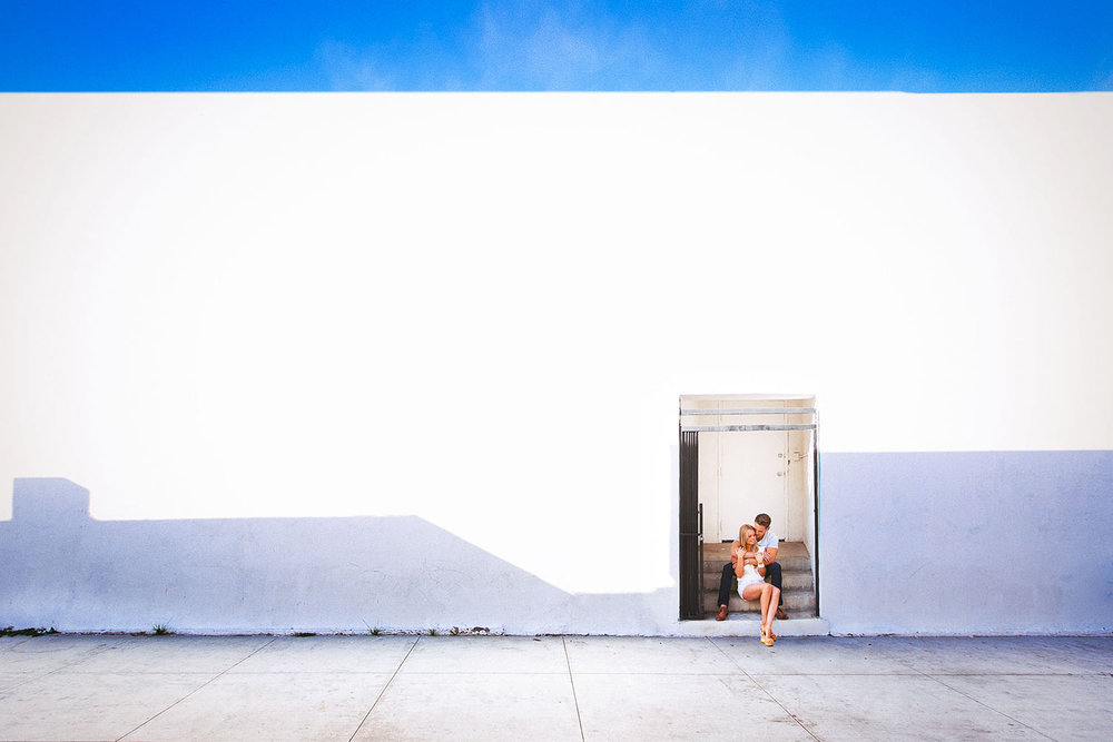 Santa Monica Engagement photo on white wall with blue sky