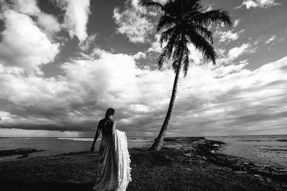 Olowalu Plantation House Wedding Photo of bride walking down beach