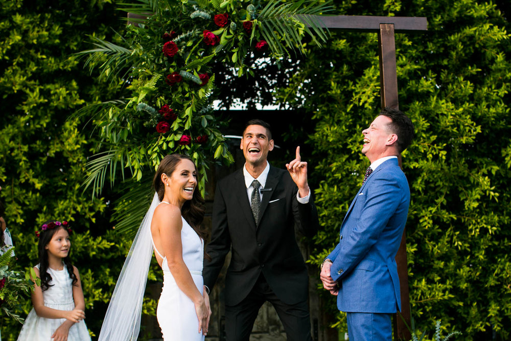 Couple laugh at their Palm Springs Wedding