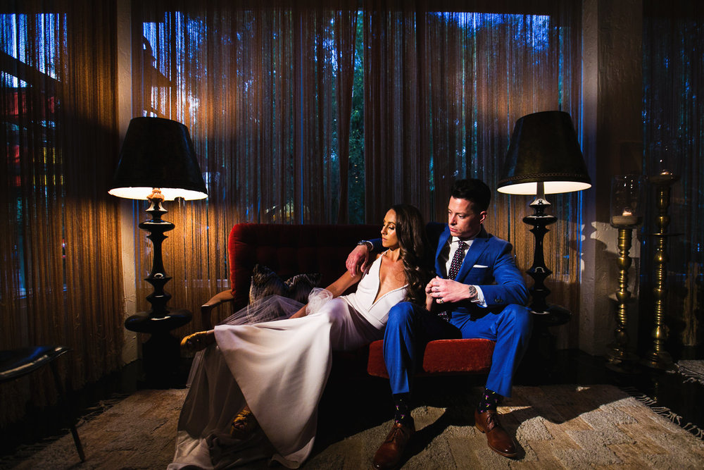 Palm Springs wedding portrait of couple on couch