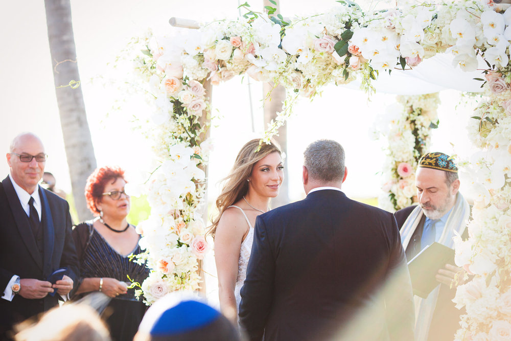 another photo under the chuppah at Outdoor Wedding Ceremony at the Four Seasons Hualalai