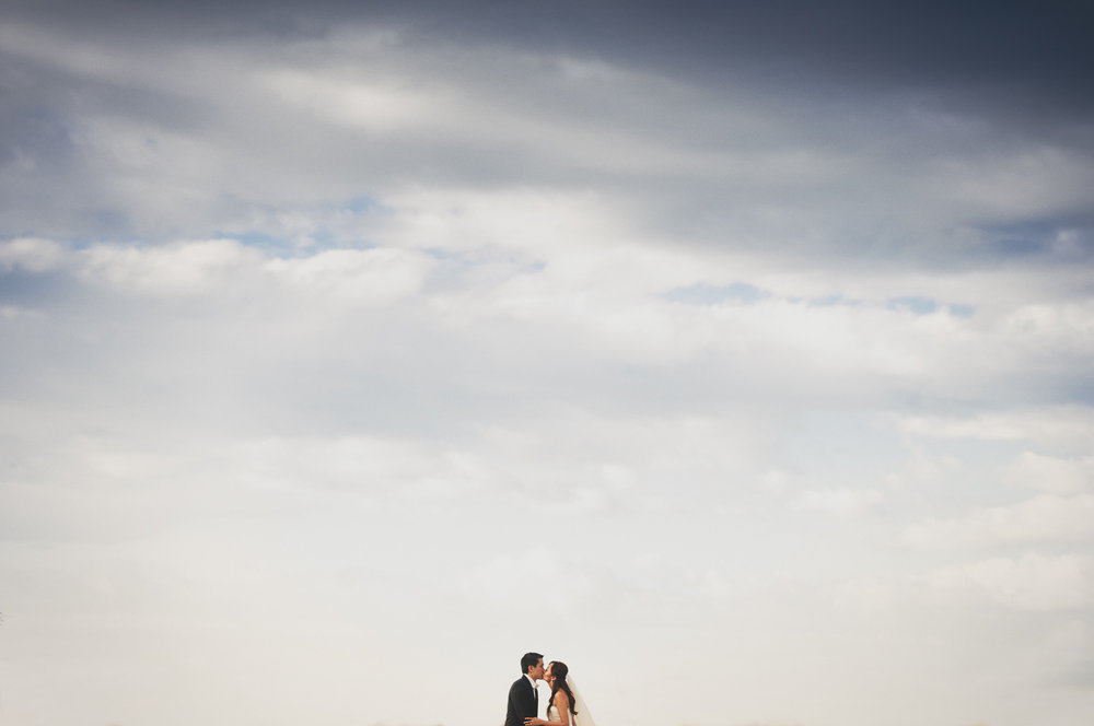 Asian wedding Four Seasons Hualalai Wedding portrait in lava fields of Kona