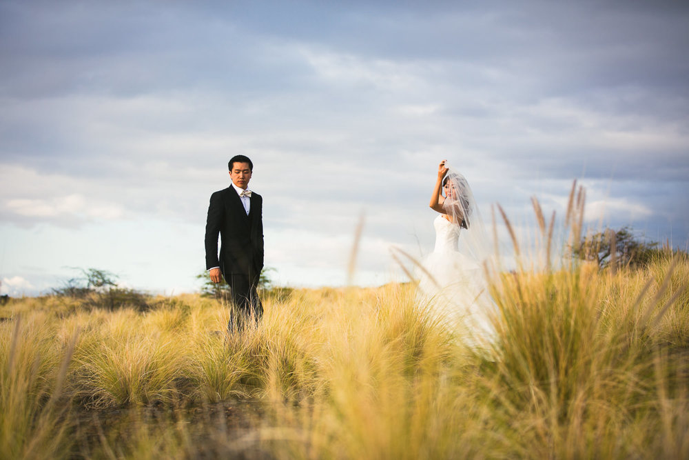 Bride and groom Four Seasons Hualalai Wedding portrait in lava fields of Kona