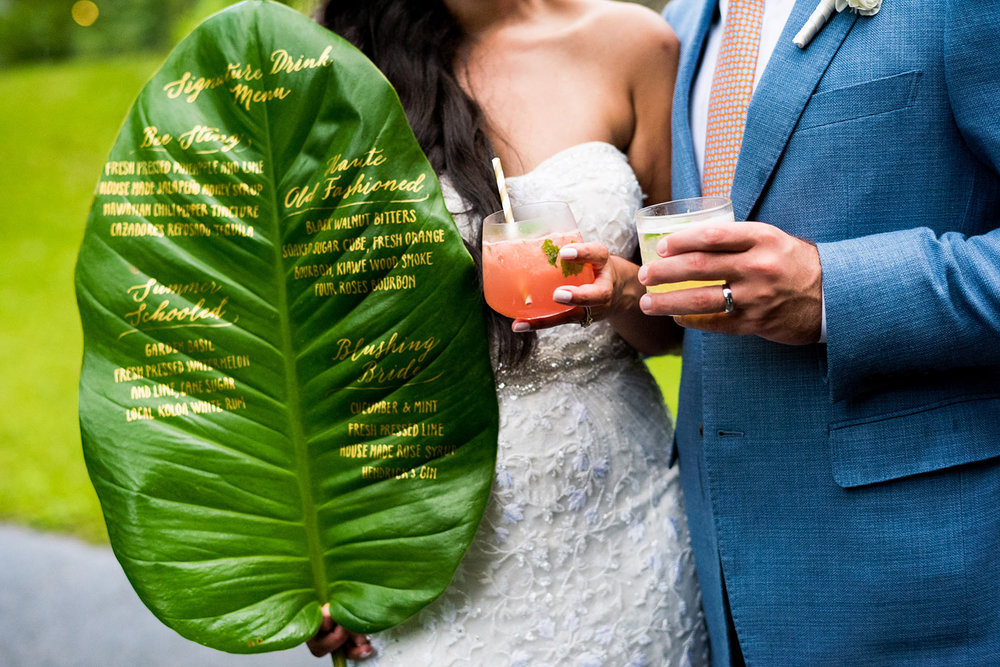Great idea for Wedding cocktail menu - write on a palm leaf