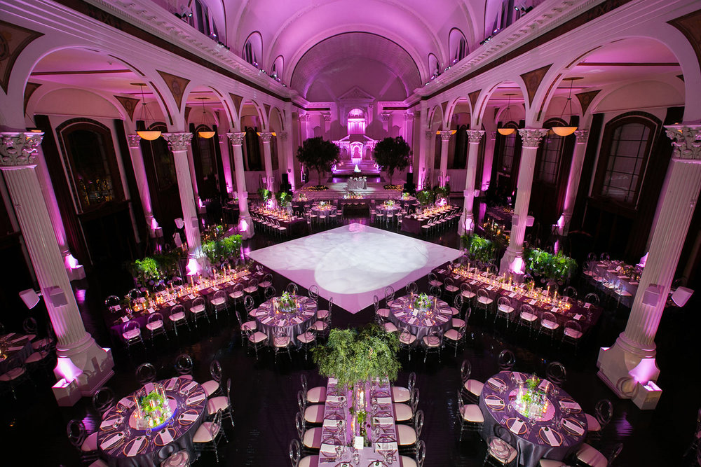 Vibiana wedding reception colored in purple with dance floor in the middle
