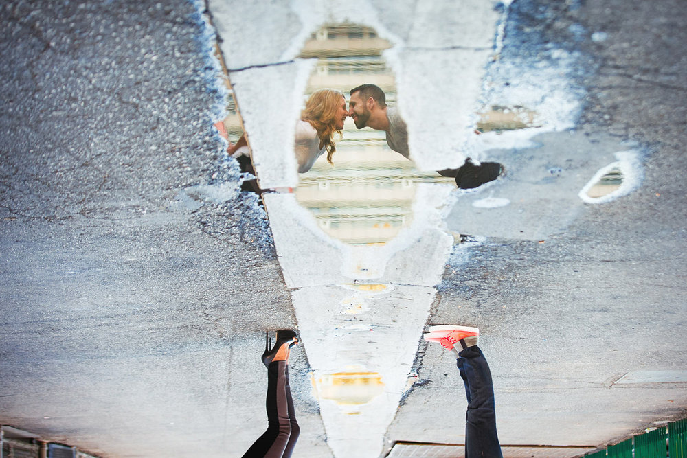 Super creative Los Angeles engagement photo idea of couple reflected in water