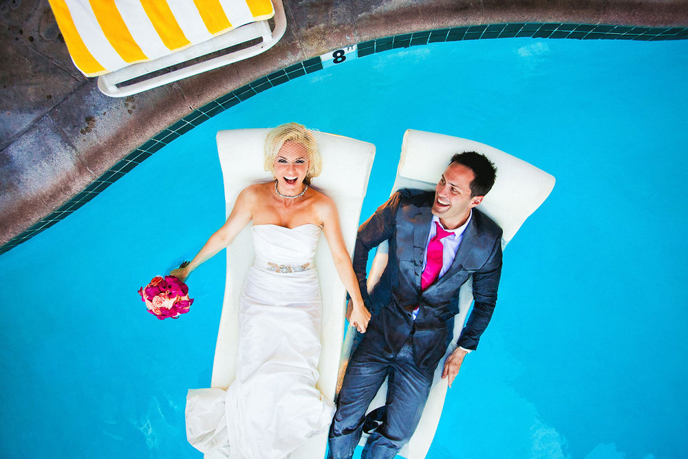 Avalon Hotel in Palm Springs wedding photo of bride and groom in pool