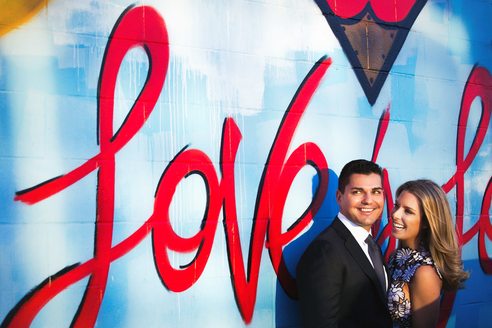 Fashionable Arts District Engagement Happy Couple