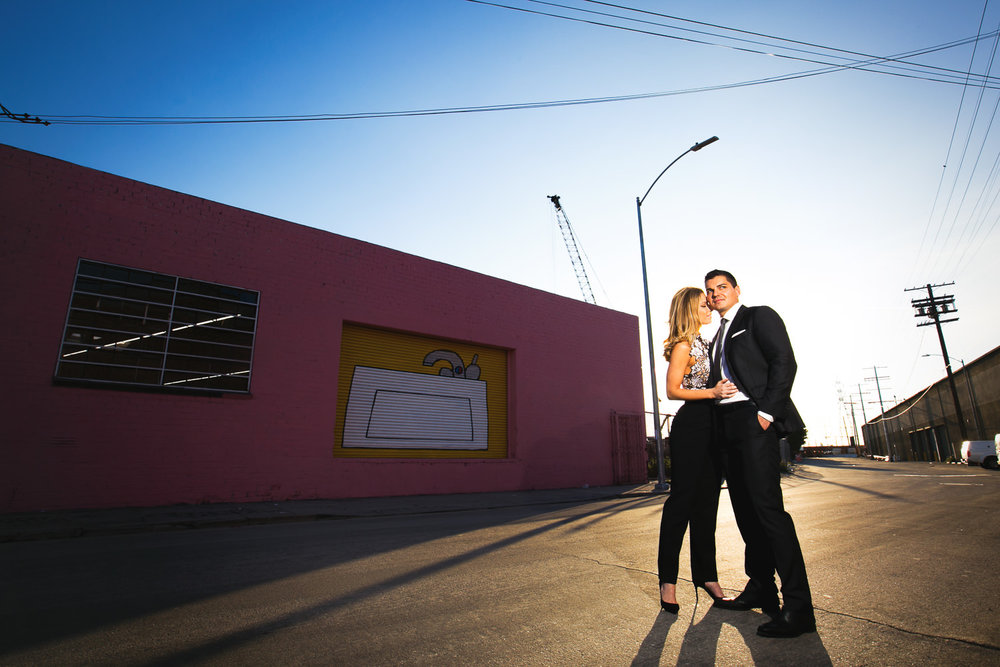 Arts District Engagement With Hip Couple Standing In The Sunlight
