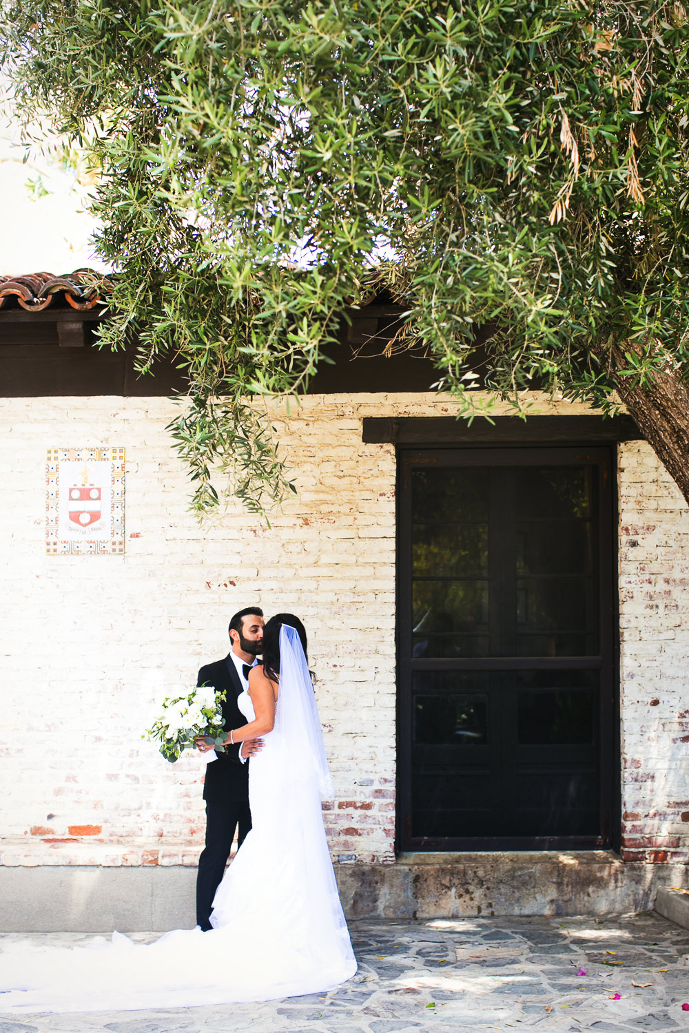 Hummingbird Nest Ranch Wedding - Persian Bride & Groom Kissing