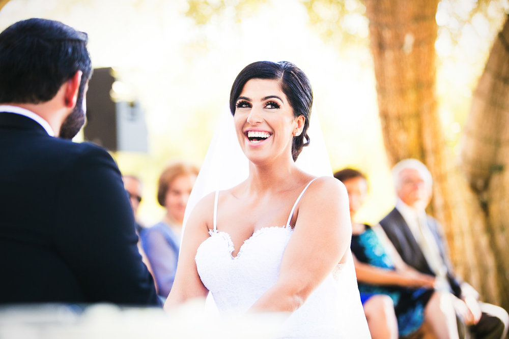Hummingbird Nest Ranch Wedding - Persian Bride Laughing