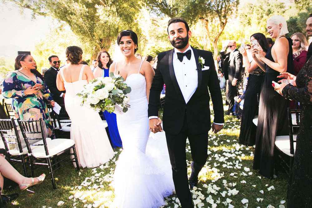 Hummingbird Nest Ranch Wedding - Persian Couple Walking Down Aisle