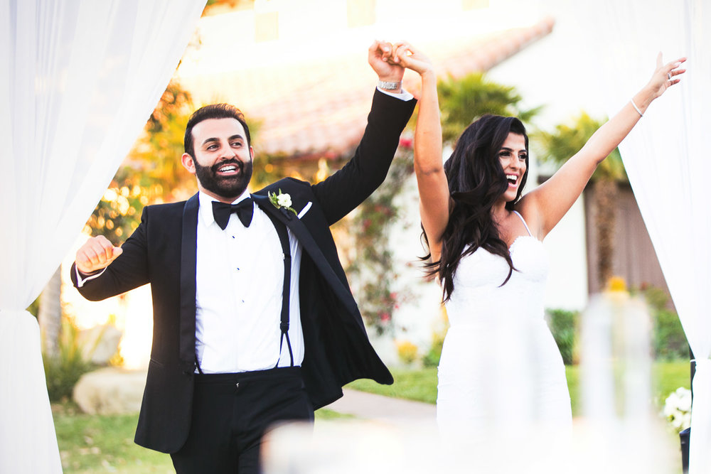 Hummingbird Nest Ranch Wedding - Persian Bride & Groom Waving