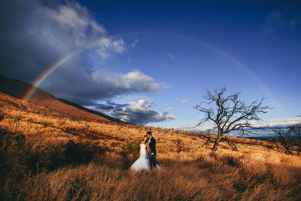 One of Brian Callaway's Favorite photos is of a bride and groom under a rainbow at their Hawaii Wedding