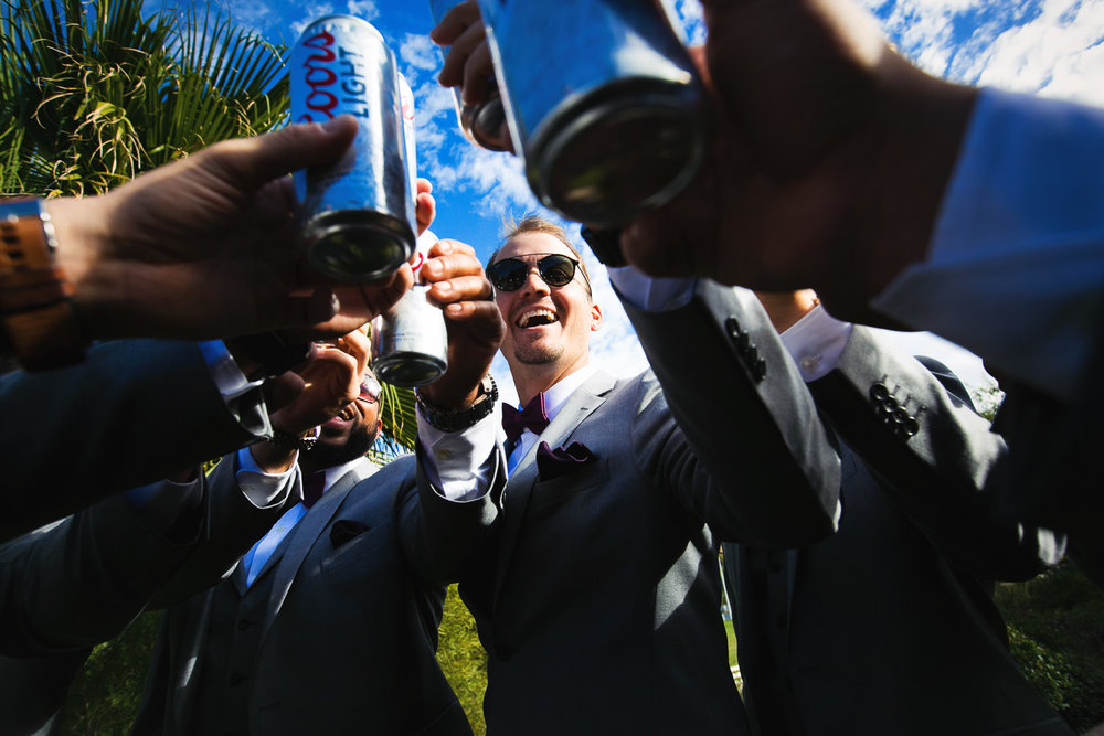 Groomsmen toasting Coors Light at Hummingbird Nest wedding by Callaway Gable