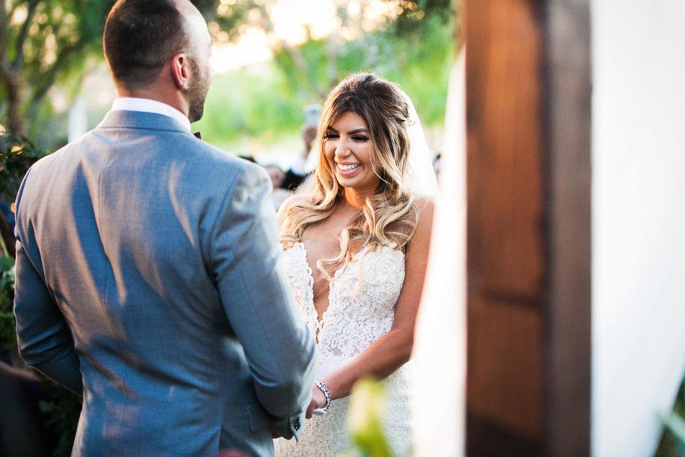 holding hands at Hummingbird Nest wedding by Callaway Gable