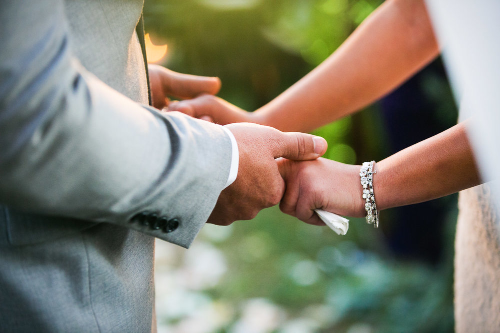 more holding hands at Hummingbird Nest wedding by Callaway Gable