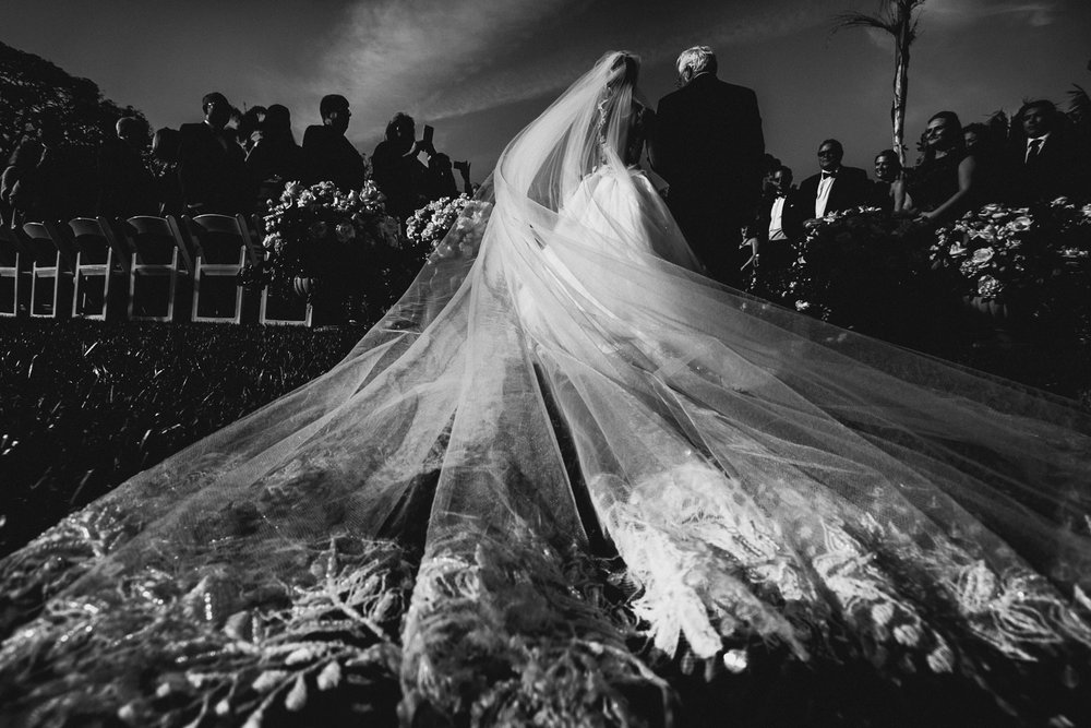 Four Seasons Santa Barbara Wedding - Black & White Of Bride Walking Down the Aisle