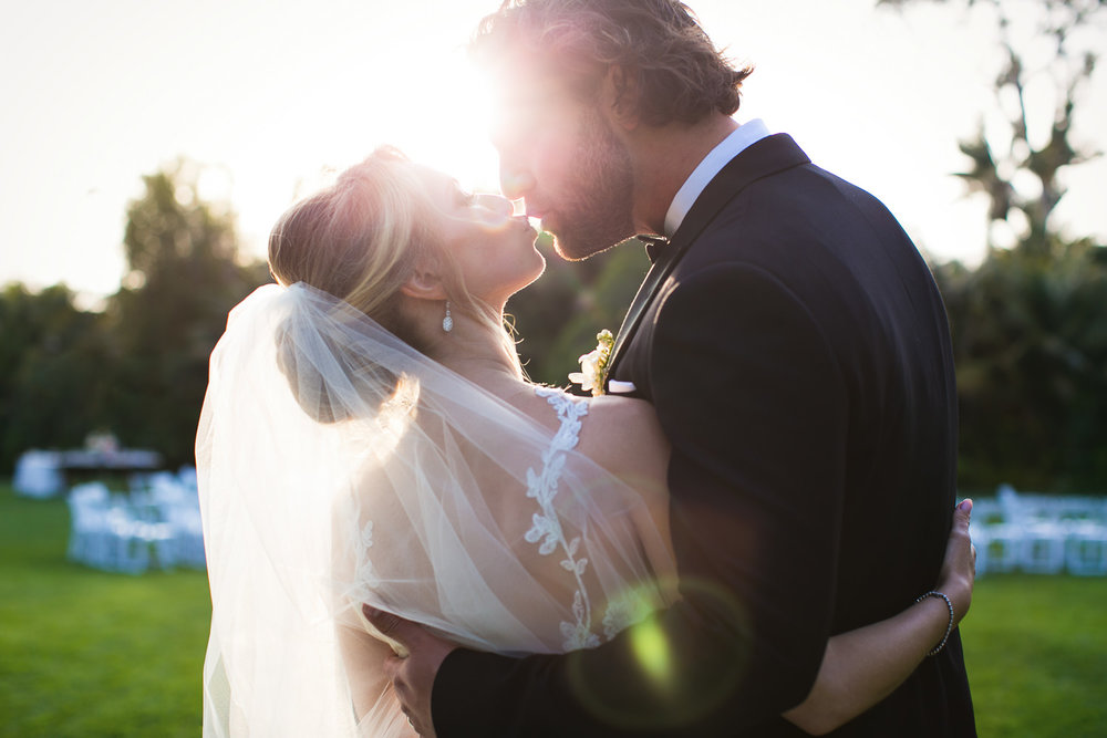 Four Seasons Santa Barbara Wedding - Sunlit Kiss